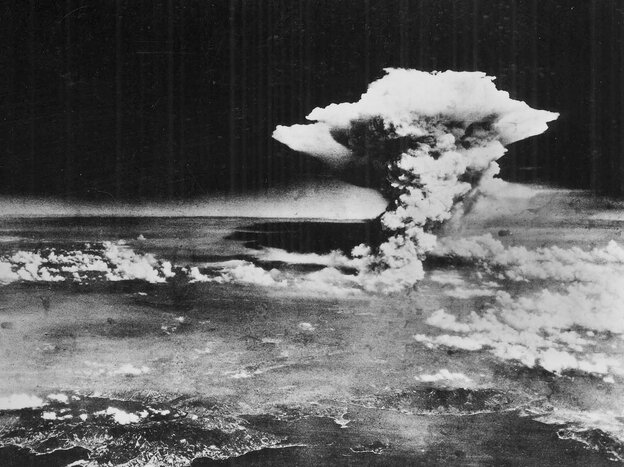 A mushroom cloud billows into the sky about one hour after an atomic bomb was detonated above Hiroshima, Japan.