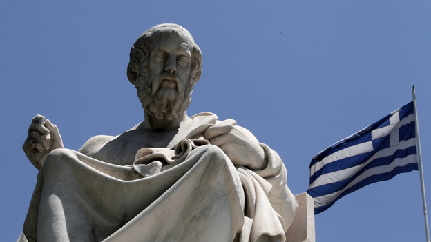The marble statue of Plato stands in front of the Athens Academy in Athens. The ancient Greek philosopher had his doubts about democracy. (AP)