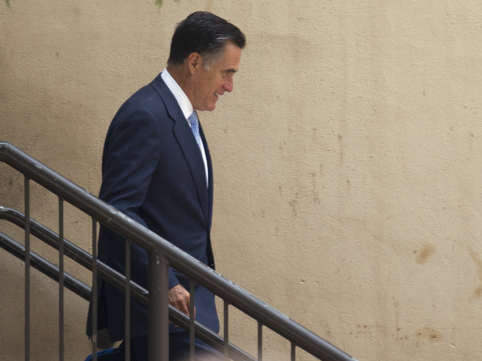 Mitt Romney leaves a fundraiser in Baton Rouge, La., on Monday. (AP)