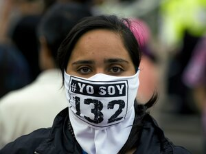 A member of the movement 'YoSoy#132' takes part in a protest against the election results, in front of the Federal Electoral Tribunal (TRIFE) in Mexico City, on July 10. The movement is protesting against Enrique Pena Nieto, candidate of the Institutional Revolutionary Party (PRI).
