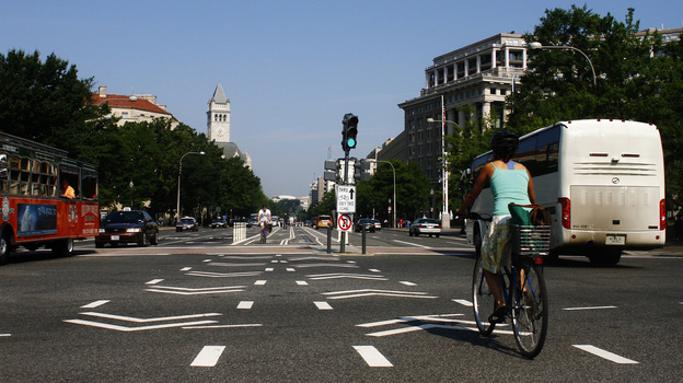 A cyclist rides in the the bike lane on Pennsylvania Avenue NW in Washington, D.C. (NPR)