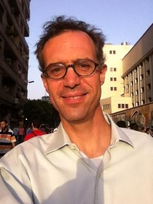 New York Times reporter David Kirkpatrick standing in Cairo's Tahrir Square.
