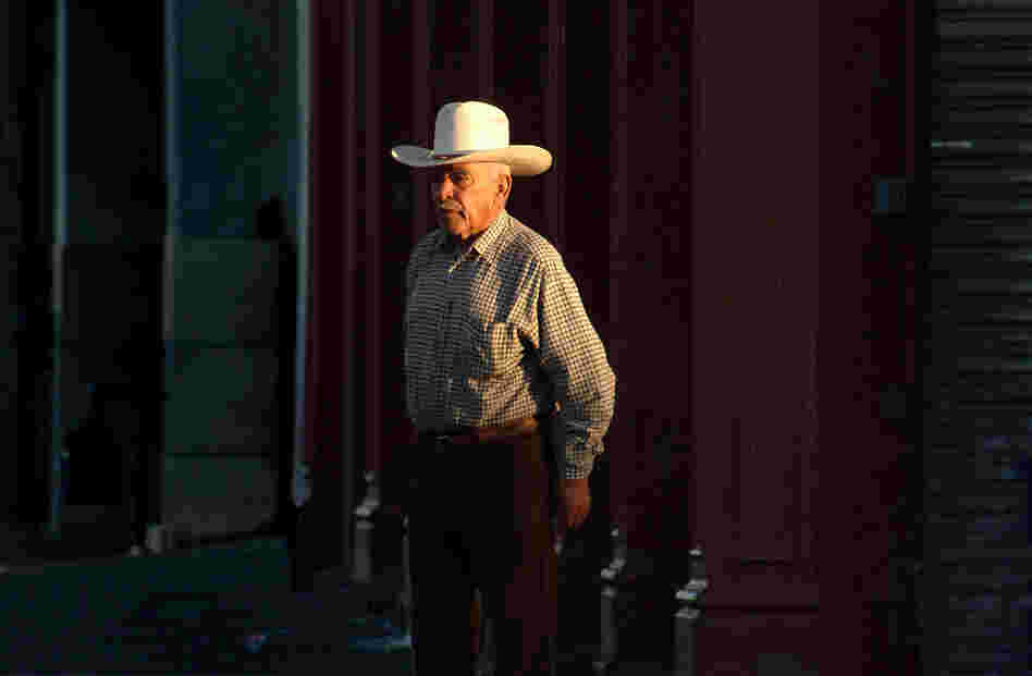 "Dignified Man, 2006. This ""viejo"" (old one) walks on this street every evening. 6th and El Paso St. This is the first street in the U.S. after crossing from Juarez into downtown El Paso. In essence, this is the first block of America (or the last, depending on which direction you're going)."
