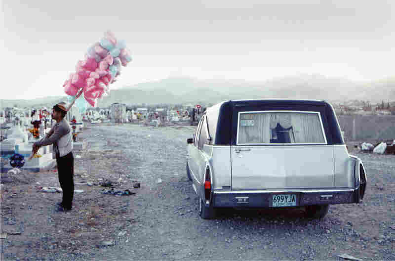 Candyman in El Panteon. The Panteon of Juarez (the municipal cemetery) on the Day of the Dead, 1994. The celebration is still honored, but there have been so many funerals in Juarez during the cartel war years that people are closer to death than is comfortable.