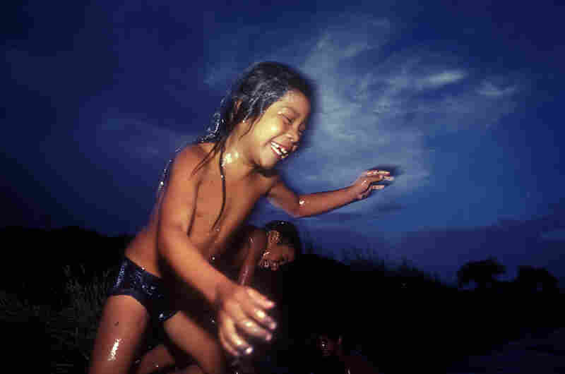 River Jump in the River with Two Names, 1989. Kids cool off in the river with two names — Rio Grande on the U.S. side, and Rio Bravo in Mexico.