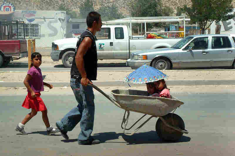 A man and his family in northeast Juarez, 2008