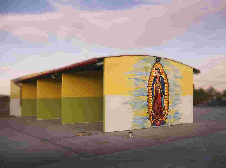 The Virgin's Car Wash, 2005. The Virgin de Guadalupe on an unfinished car wash in El Paso.