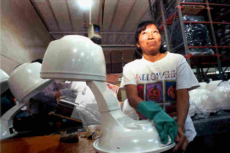 Woman in an assembly plant in Juarez (known as a maquila), 1999.