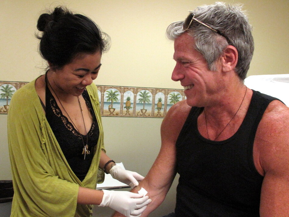 Nurse Priscila-Grace Gonzaga with Gregg Cassin, a San Francisco gay man who has been infected with HIV since the early 1980s. He's a volunteer in a cutting-edge gene therapy experiment to see whether HIV-infected people can be given an immune system that is invulnerable to HIV infection.