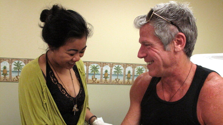 Nurse Priscila-Grace Gonzaga with Gregg Cassin, a San Francisco gay man who has been infected with HIV since the early 1980s. He's a volunteer in a cutting-edge gene therapy experiment to see whether HIV-infected people can be given an immune system that is invulnerable to HIV infection. (NPR)