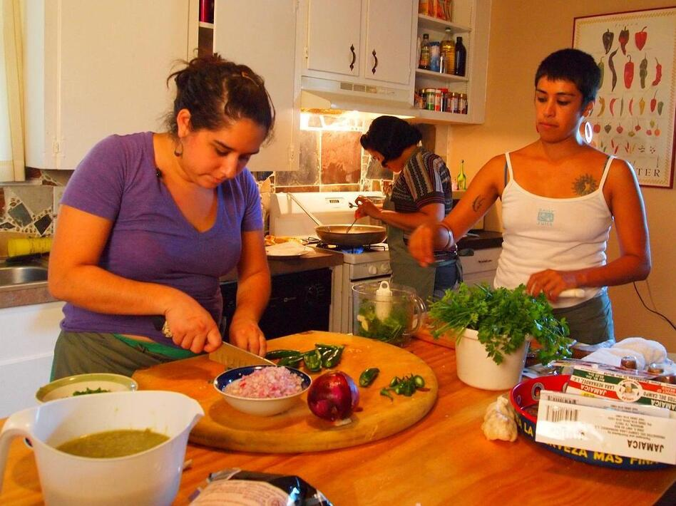 Raquel Rodriguez and Sylvia Barrios work at Yo Mama's Catering Cooperative, the first worker-owned catering business in Austin, Tx. (JumpStart Productions LLC)