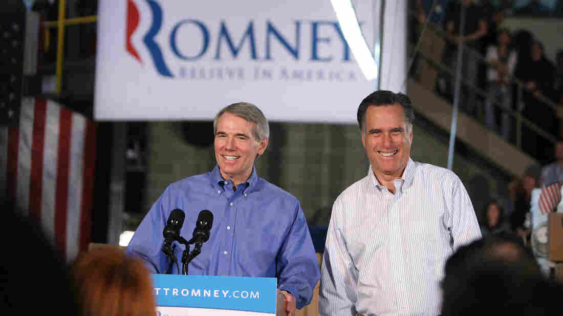 Sen. Rob Portman, R-Ohio, campaigns with Mitt Romney in Cincinnati on Feb. 20.