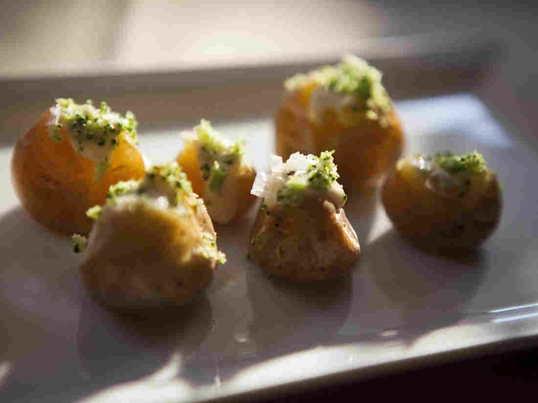 Tiny spuds decked out with cheese fondue sauce and a sprinkling of broccoli shavings at a dinner sponsored by the U.S. Potato Board.
