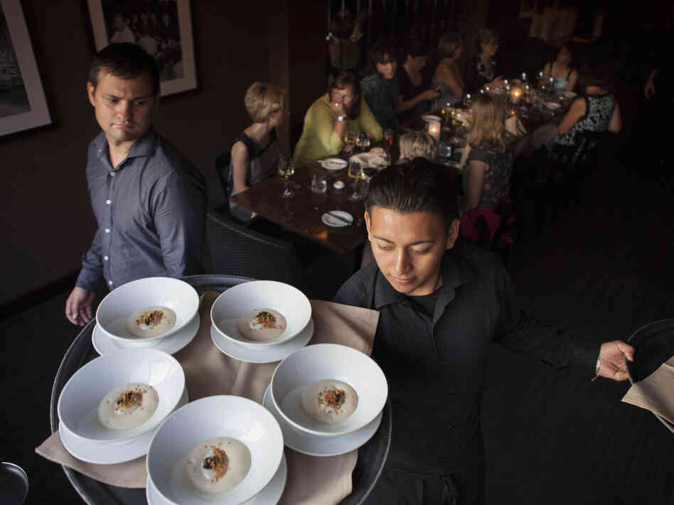 Waiters at Ardeo-Bardeo in Washington, D.C. serve smoked white potato mousse with egg and caviar.