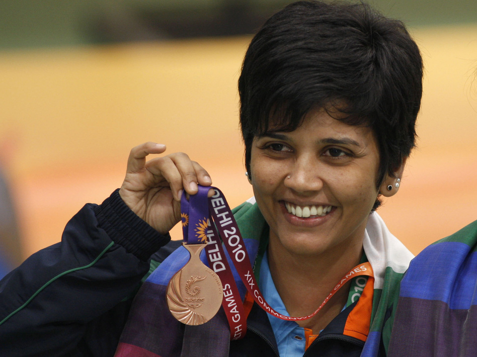 India's Suma Shirur won bronze in women's 10m air rifle pairs at the 2010 Commonwealth Games in New Delhi. She says her part-time government job gave her the time and financial stability to train for the 2004 Olympics in Athens. (AP)