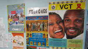 Anti-AIDS posters at the Eshowe public health clinic in Kwazulu Natal, South Africa. Clinicians there are hoping to slow the spread of HIV by getting more people treatment.