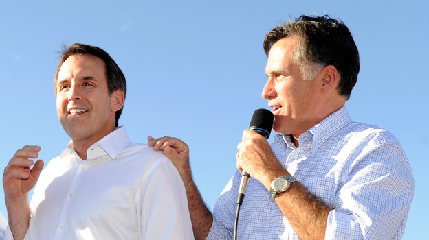 Former Minnesota Gov. Tim Pawlenty and GOP presidential candidate Mitt Romney campaign in Las Vegas on Oct.  17, 2011. (Getty Images)