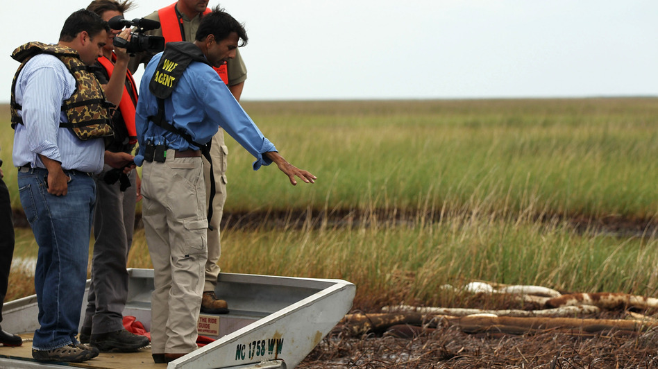 Louisiana Gov. Bobby Jindal checks out damage off Grand Isle, La., from the Deepwater Horizon oil spill in June 2010.
