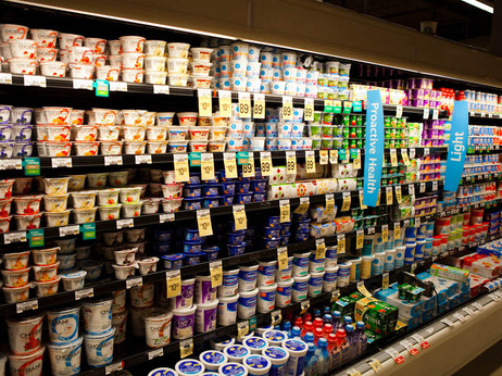 A supermarket's dairy case with shelves of yogurt