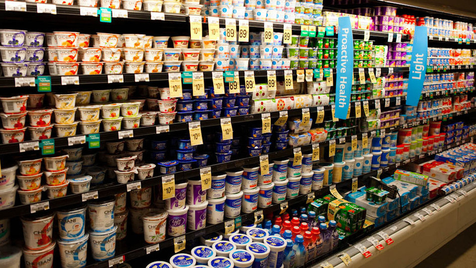 A supermarket's dairy case with shelves of yogurt. (NPR)
