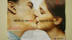 """An HIV awareness campaign in a counseling room at the San Francisco de Assisi Hospital in Rio de Janeiro, Brazil. The poster says, """"One of them has HIV. The other one knows."""""""