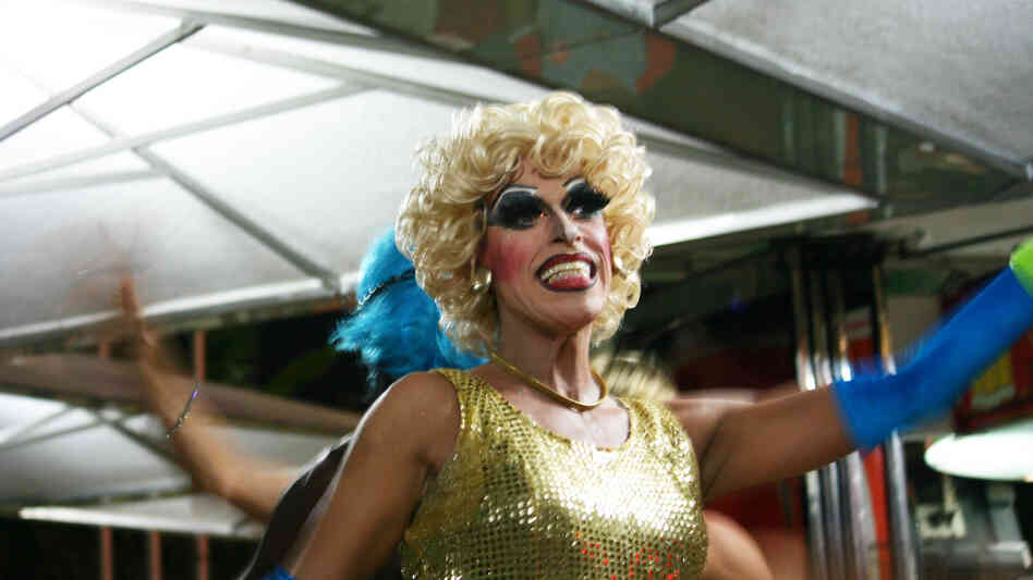 Drag queens at an outdoor restaurant in Copacabana incorporate safe sex messages into a show of lip-synced songs and risque jokes.