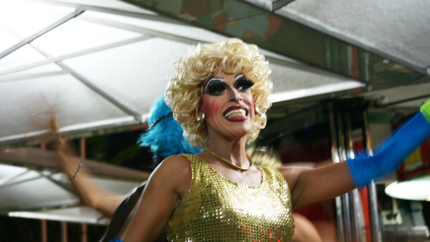 Drag queens at an outdoor restaurant in Copacabana incorporate safe sex messages into a show of lip-synced songs and risque jokes. (NPR)