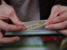 A marijuana cigarette in British Columbia. Our panel of economists agrees that criminalizing pot is a huge waste of resources.