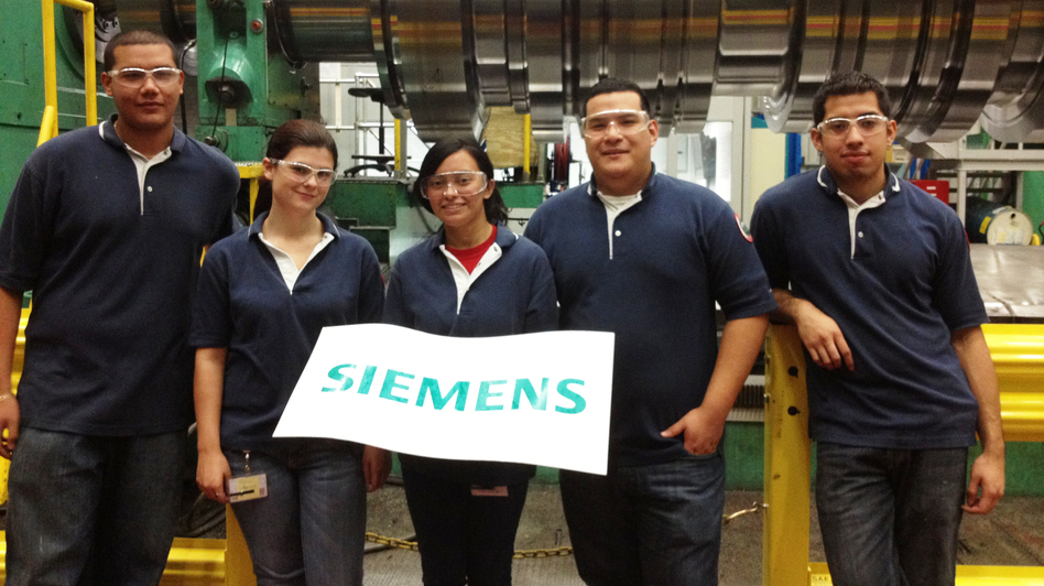 Rebeca Espinal (center) and other apprentices work on Siemens' factory floor in Charlotte, N.C. (Asma Khalid for NPR)