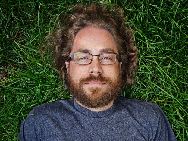 Ask Me Another resident musician, Jonathan Coulton, keeps audiences entertained with his offbeat lyrics and entertaining covers of popular music. JoCo quit his day job writing software in 2005 to pursue a career in music. (Courtesy of Jonathan Coulton)