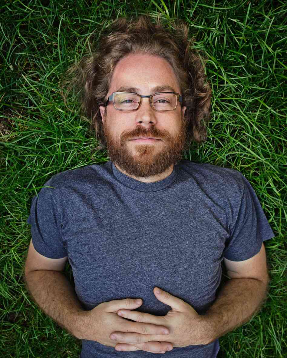 Ask Me Another resident musician, Jonathan Coulton, keeps audiences entertained with his offbeat lyrics and entertaining covers of popular music. JoCo quit his day job writing software in 2005 to pursue a career in music.