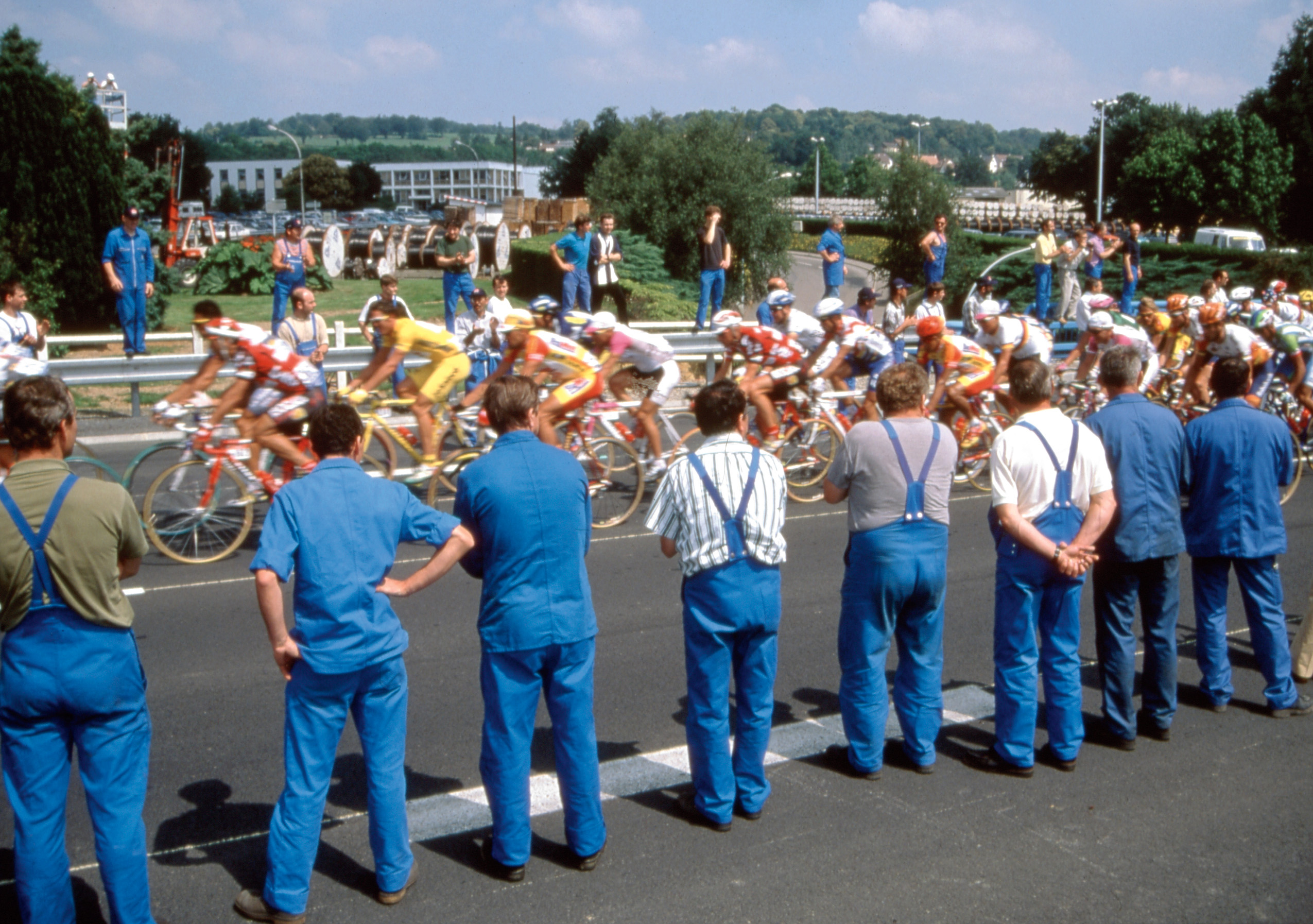 """I was out on the course and there was nothing. Then all of a sudden the road came up on a factory, and there was a sea of workers in blue uniforms. It was perfect -- the pattern of the blue bibs,"" says Startt about this photo from the 1997 Tour."