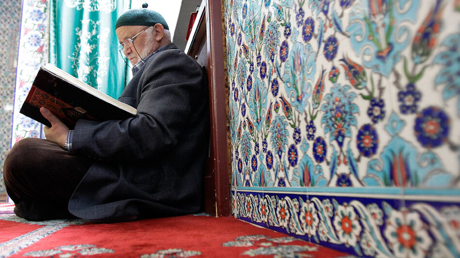 A man reads the Quran inside a mosque in Hamburg, northern Germany.