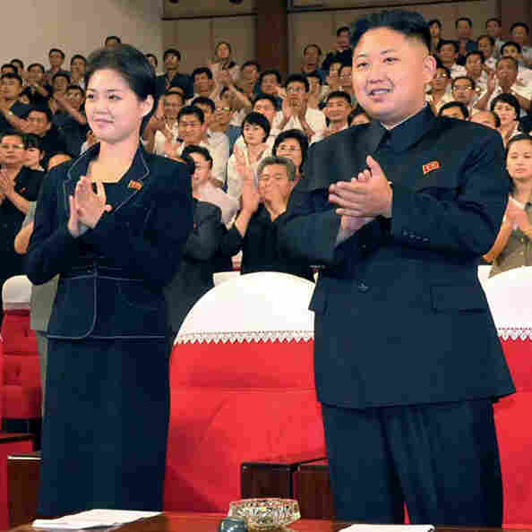 In this photo released by the Korean Central News Agency and distributed in Tokyo by the Korea News Service on July 9, North Korean leader Kim Jong Un is seen with a woman in Pyongyang. It's not clear who she is, but a first lady would be a marked departure from the days of Kim's father, who kept his personal life private.
