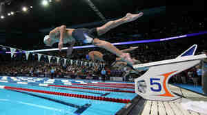 Researchers studying brains want to know what's happening in an area called the premotor cortex — the place in the brain that gears up for something the body is about to do, like swimming. Above, Michael Phelps dives off the starting blocks in the final heat of the men's 400-meter individual medley during the 2012 U.S. Olympic Swimming Team Trials in Omaha, Neb., on June 25.