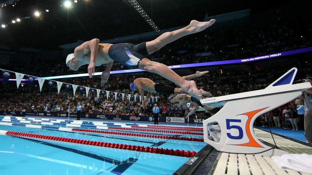 Researchers studying brains want to know what's happening in an area called the premotor cortex — the place in the brain that gears up for something the body is about to do, like swimming. Above, Michael Phelps dives off the starting blocks in the final heat of the men's 400-meter individual medley during the 2012 U.S. Olympic Swimming Team Trials in Omaha, Neb., on June 25. (Getty Images)