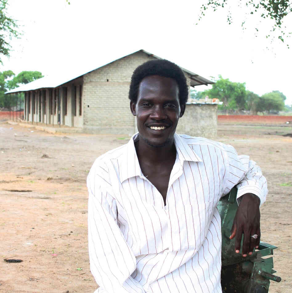 Rudwan Dawod stands in front of a school he helped build in Turalei, South Sudan. The Oregon resident is now detained in Sudan, accused of terrorism after he participated in protests there.