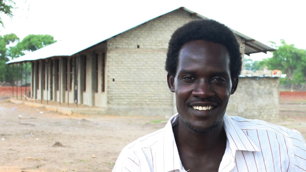 Rudwan Dawod stands in front of a school he helped build in Turalei, South Sudan. The Oregon resident is now detained in Sudan, accused of terrorism after he participated in protests there. (Courtesy of Nancy Williams Dawod)