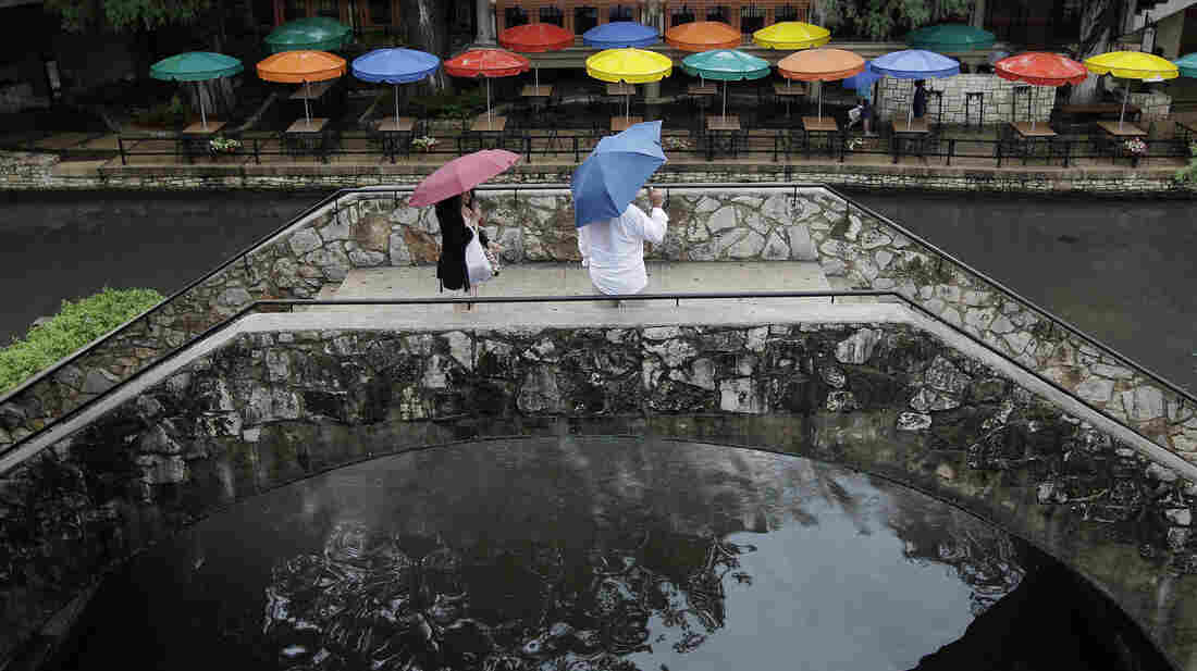 Pedestrians stand along the River Walk in San Antonio, Texas, in May. The state has gotten a reprieve from more than a year of drought.
