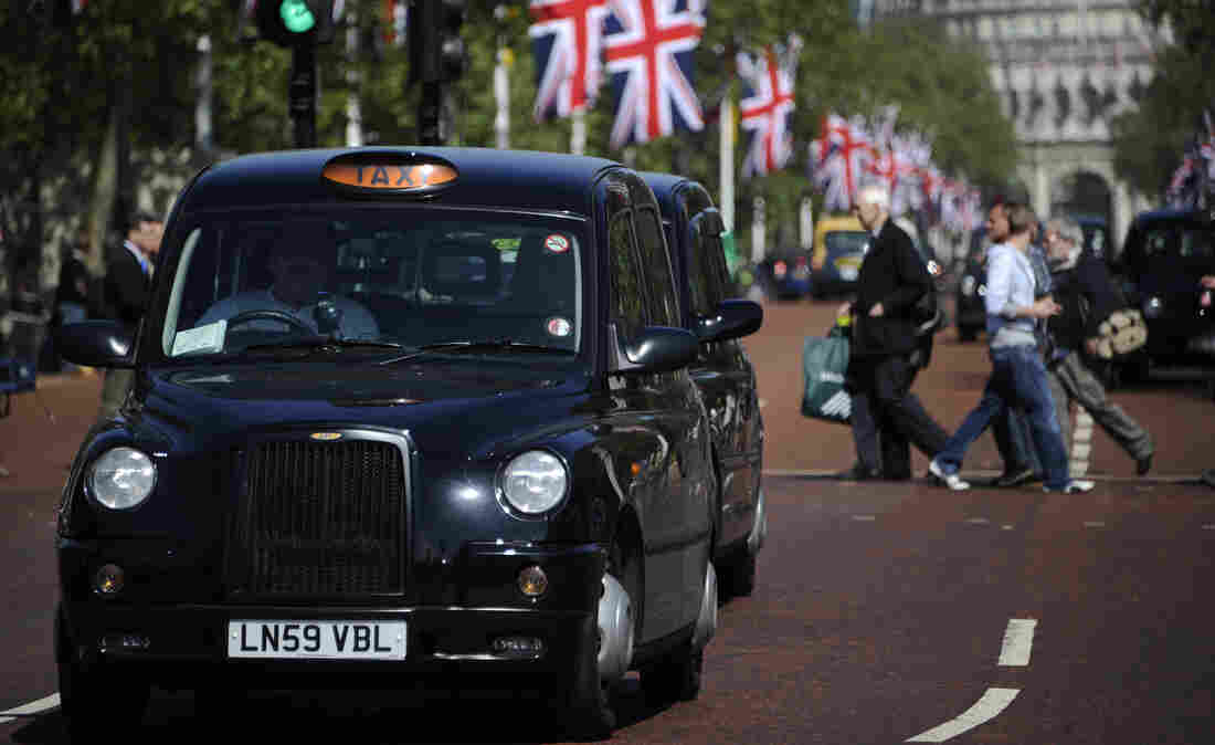 Black taxis drive through London. Weekend Edition knows one London cabbie who treats reading like an Olympic sport.