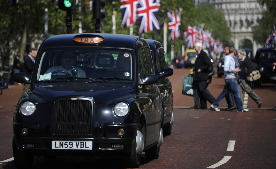 Black taxis drive through London. <em>Weekend Edition</em> knows one London cabbie who treats reading like an Olympic sport.