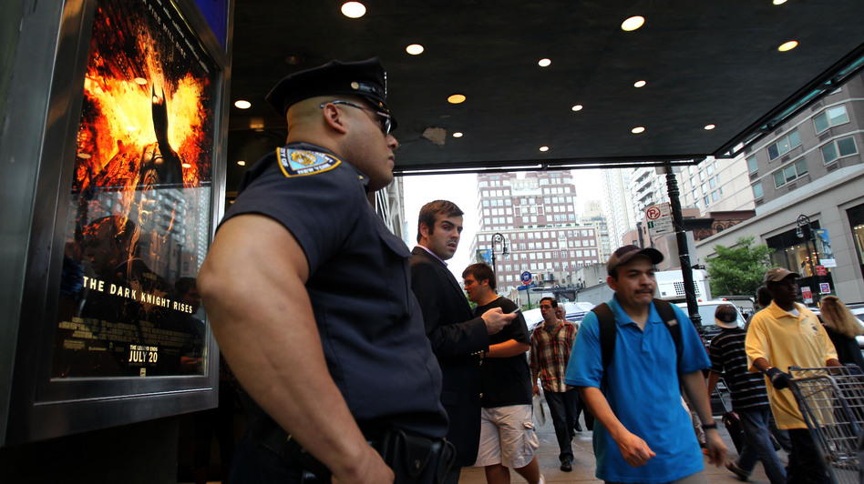 "A policeman stands outside a movie theater in New York on Friday during a showing of ""The Dark Knight Rises."" (AFP/Getty Images)"