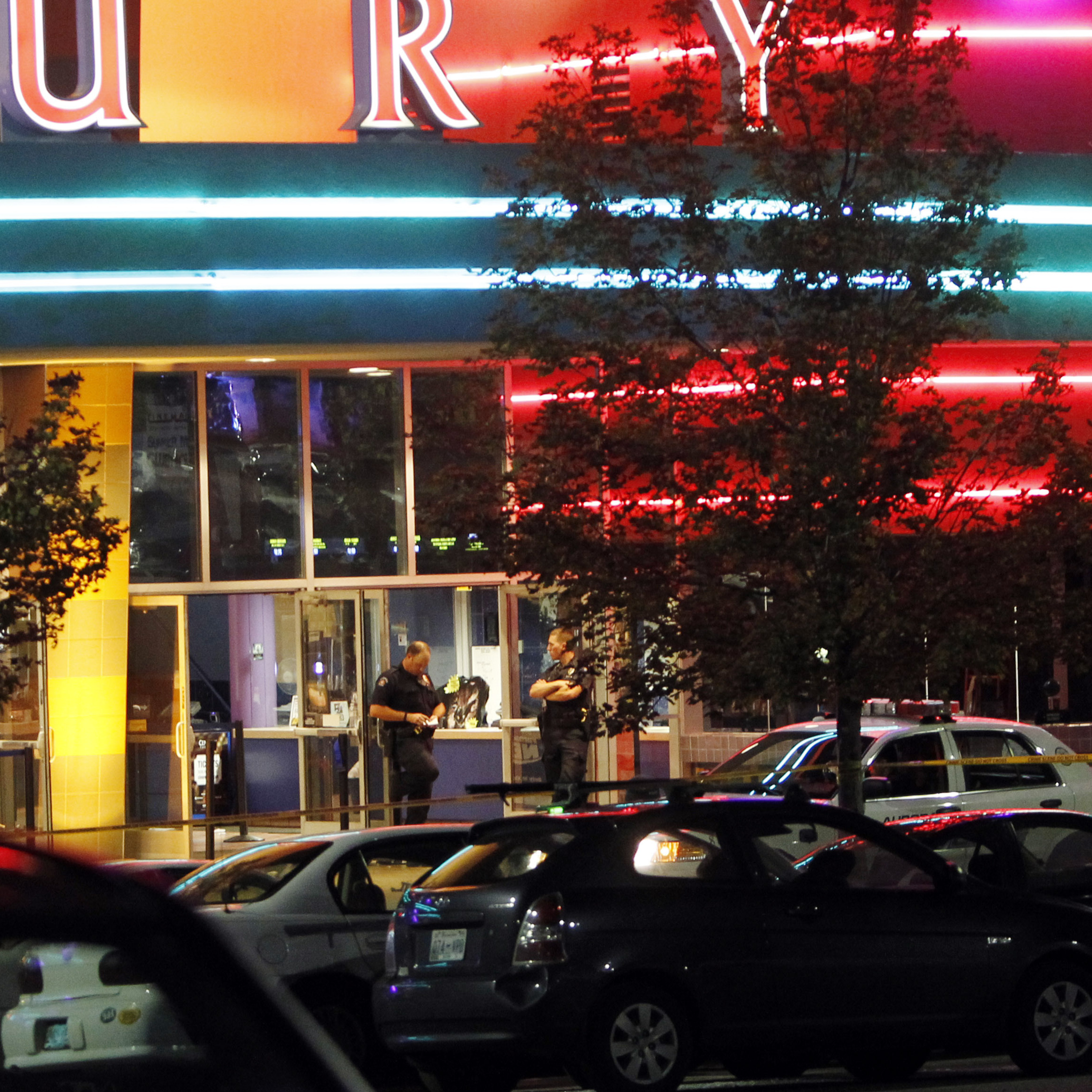 A police officer outside the Century 16 movie theater in Aurora, Colo., early Friday after a gunman opened fire on people watching a midnight screening of The Dark Knight Rises.