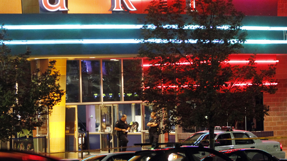 A police officer outside the Century 16 movie theater in Aurora, Colo., early today after the shooting rampage. (AP)
