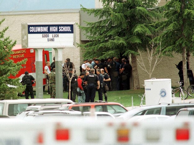 Police gathered at the east entrance of Columbine High School in Littleton, Colo., on April 20, 1999, after two teen students went on a shooting rampage before turning the weapons on themselves.