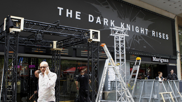 Workers dismantle an installation that was set up for the premiere of The Dark Knight Rises in Paris. It had been scheduled for Friday night but was canceled after a gunman killed 12 people at a Colorado opening of the same film. (AP)
