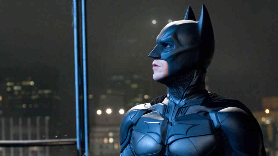 Emotional Armor: Superheroes like Batman (Christian Bale) function as talismans when our fears are darkest — symbols of good, and of justice, when we wonder whether either exists.