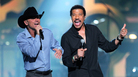 Kenny Chesney (left) performs with Lionel Richie at an April 2 event called Lionel Richie and Friends in Concert in Las Vegas. Other performers at the concert included country stars Tim McGraw, Jason Aldean, The Band Perry and Rascal Flatts.
