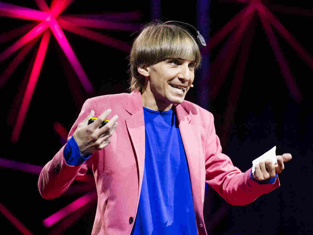 """Sonochromatic cyborg"" and artist Neil Harbisson — with the implanted device that converts color to sound — at his TED talk in Edinburgh last month."