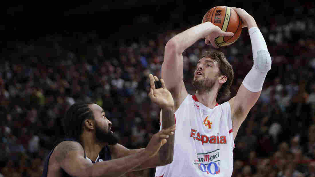 Spanish star Pau Gasol shoots over France's Ronny Turiaf during a pre-Olympic game earlier this month. Gasol, who regularly plays for the Los Angeles Lakers, was Spain's leading scorer in the 2008 Olympics, when the team won a silver medal. The Spaniards may have the best chance of upsetting the favored U.S. team at the London Olympics.
